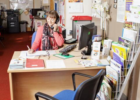 Image of one of our receptionists taking a telephone call