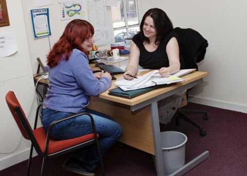 Picture of staff working with a client