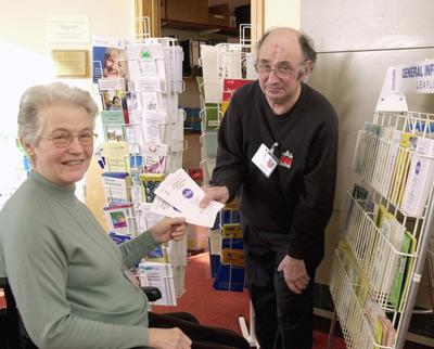 Image of two Disability Information Bureau volunteers at work